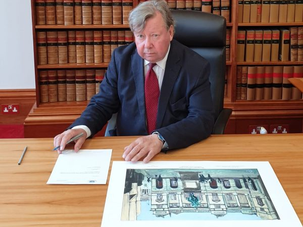 Lord Carloway signs the limited edition print and letter of authenticity